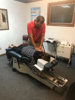 Todd Nobbe of Nobbe Chiropractic in Columbia IL treating back pain